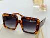 Amber frame gradient gray lenses