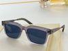 clear grey framed blue lenses
