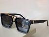 Black gold framed gray lenses