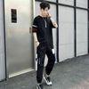 Siyah dört kutuplu pantolon takım elbise