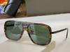 amber frame green lens