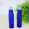 Cheap Wholesale 700pcs 10ml Blue Color Glass Bottles With Stainless Steel Roller And Black Lid For E Liquid Oil Perfume Free DHL Shipping