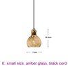 small, amber glass, black cord