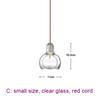 small, clear glass, red cord