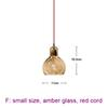small, amber glass, red cord