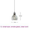small, smoke glass, clear cord