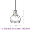 large, clear glass, black cord