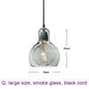 large, smoke glass, black cord