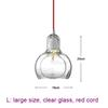large, clear glass, red cord