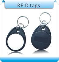 Livraison gratuite 50pcs ABS matériel blackwhite 4 # TK4100 125KHZ RFID clés chaîne étiquettes / carte de système de contrôle d'accès