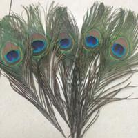 Plumes de queue de paon 100pcs / lot élégant Matériaux de décoration réel naturel paon plumes Parti Décoration Plumes de paon 25-30cm