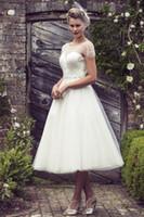 2015 매력적인 티 길이 웨딩 드레스 데코 페르시 몸통 구슬 장식용 슬리브 블라인드 드레스 Tulle Beach 웨딩 드레스