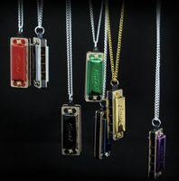 新しい熱い販売4穴8トーンミニハーモニカの服装の首のチェーンデザイン楽器子供の色のランダム