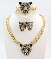 Женщины позолоченные леопардовые кристаллические ожерелье / браслеты / серьги набор ювелирных изделий