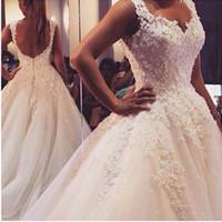 Ny ankomstpärlor spetsar bröllopsklänningar våren 2016 Baklösa pärlstavsbalkar Brudklänning med blommor Lace Applique Luxury Bridal Gown