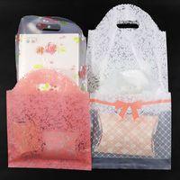 50pcs grande taille en plastique avec poignée Sacs en tissu sac de rangement Parti Sac emballage cadeau de mariage Boutique Porte-sacs en plastique