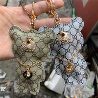Animal bonito chaveiros Pu couro marca design urso charme chaveiro para carros cristal rhinestone pingente chaveiro titular saco de jóias keyring