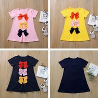 Camisetas de las muchachas de la falda del Bowknot linda muchacha de la princesa del vestido de los niños ropa de vestir de verano de manga corta de la camiseta larga CZ409 encanto del color del caramelo Niño