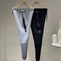 2019 New Mens Designer Tech Fleece Pantalones deportivos Pantalones Hip Hip Streetwear Men's Sport Marca Espacio Algodón Pantalones corriendo