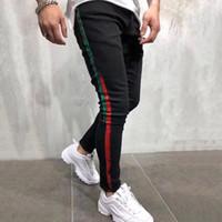 ممزق جديد أزياء الرجال الجينز الرجال المصمم الملابس عالية الجودة تنفس سروال جينز ذكر اللون الشريط الطباعة جينز