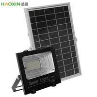 HaoXin LED تعمل بالطاقة الشمسية الأضواء الكاشفة في الهواء الطلق حديقة الحديقة مصابيح المناظر الطبيعية للماء جدار الأمن مصابيح الضوء الكاشف + التحكم عن بعد