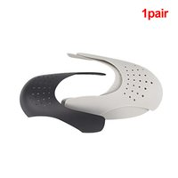 1 par lavable del dedo del pie del zapato ayudas de la PAC Camilla práctica anti pliegue de flexión de la grieta universal zapatilla de deporte Escudo talladora Expander