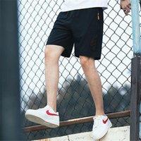 أزياء الرجال السراويل القصيرة الصيف فضفاض تنفس نمط الرياضة بنطال رياضة مخطط الرباط السريع تجفيف السراويل الرياضية مصمم