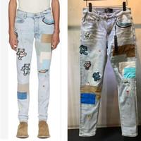 Hombres de alta calidad Jeans Skinny Agujeros Ripped Jeans Motorcycle Biker Denim Pantalones AI Moda Hip Hop Famosos Pantalones de mezclilla