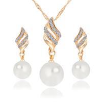 Top Selling artificielle Perle Boucles d'oreilles Collier 2piece Set Set Bijoux en cristal Mode Pendentif Spirale Femme Mariage