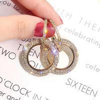 S925 aguja de plata Versión coreana de la nueva moda con pendientes de diamantes. Pendientes de círculo con geometría de diamante hembra de Europa y Estados Unidos