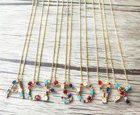 Trendy ciondolo in oro con ciondolo grande lettera dell'alfabeto CZ, micro ciondolo CZ multicolore e gemme con ciondoli in pietra collana di gioielli NK427