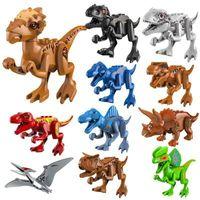 3D41901-08 / JM027-38 84pcs / lot Ladrillos de bloques de construcción Dinosaurio pterosaurio Indomirus T-Rex Triceratops Ladrillo juguetes para bebés regalo para niños