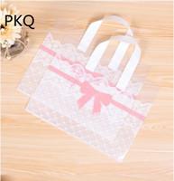 100 piezas de plástico bolsas de regalo con asas paquete Boutique Carrier Bolsa de la compra de plástico bolsas de compras del bolso del regalo de ropa grande