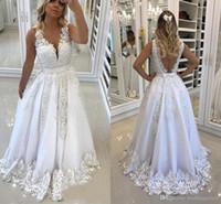 Los últimos vestidos de novia de lujo con cuello en V y una línea Apliques hasta el suelo Con cuentas Sin espalda Sin mangas Vestidos de novia Vestidos de novia