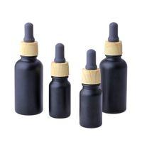 Verre noir mat E Fibre d'huile essentielle liquide bouteille de parfum avec goutte à gouttes de pipette et grain de bois 10 / 30ml