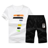 Survêtement Hommes 2018 été deux pièces Set Short Et Top Costumes Casual Vêtements de sport Vêtements pour hommes O Neck T Shirt + moitié Pantalon Longueur