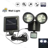 Solar Security Security Lighting Capteur de mouvement 22 LED Double Têtes imperméables pour garage extérieur Street Wall Lights Jardin Yard DHL