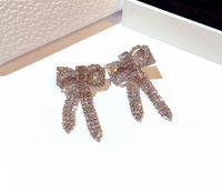 Wholesale- Stil ins Designer Super Mode Luxus Diamanten funkelnden Zirkon nette reizende Bogen-Bolzenohrringe für Frau Mädchen