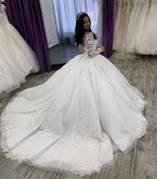 Luxury Ball Gown Wedding Dresses Long Sleeve Jewel Neck Beads Appliques Tulle Bridal Gowns Sweep Train Vestidos De Novia