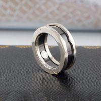 Europa América Moda Men Lady Mulheres Titanium Aço Charity Versão Gravada B Letter Preto Cerâmica Ouro 18K Limite Amantes Anéis US5-US10
