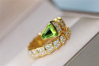 B Snake Ring gold and green natural olivine springy design j...