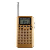 Mini Lcd Dijital FM / AM Radyo Hoparlör Çalar Saat Ve Zaman Ekran Fonksiyonu Ile 3.5mm Kulaklık Jakı Ve Şarj Kablosu