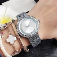 Fashion Marke schöne Frauen-Mädchen voll Kristall-große Buchstaben Art Metallzifferblatt Stahlband Quarz-Armbanduhr M85