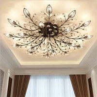 Moderna araña de cristal K9 LED de montaje en descarga Luces de techo Lámparas de oro Negro Lámparas para casas para sala de estar Dispositivos de cocina
