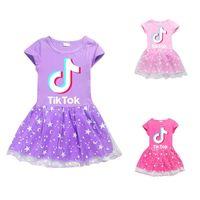 1 unids Venta Tik Tok Falda de manga corta de niña Material de algodón y malla disponible en 3 tamaños de colores 110 ~ 140 Vestidos de niña