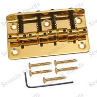 Un insieme di oro Vintage Top Load 4 appoggiate, Electric Bass Ponte Accessori per Chitarra Lunghezza 80 millimetri parti di strumenti musicali