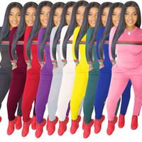 Conjuntos Skinny manga comprida Pullover fêmeas 2pcs cor pura senhoras sportswears com bolsos 2020 Primavera Womens sólidos Fatos listradas