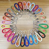 Cuoio intrecciato Portachiavi Jewelry Key Chain di modo multi funzione Portachiavi metallo Portachiavi Auto Car Key Bag anello di fascino accessori 34Color