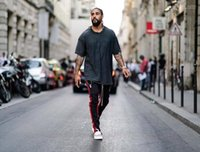 Quick Dry Traspirante Hip Hop Maschio Abbigliamento Uomo Estate Designer allentato Five Point maniche oversize Tees