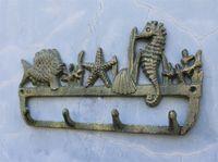 2 piezas de estilo Mar Beach Sea Shell bastidor de hierro fundido de montaje en pared Key Holder Escudo gancho de la suspensión del caballo de mar peces marinos decoración retro naturaleza